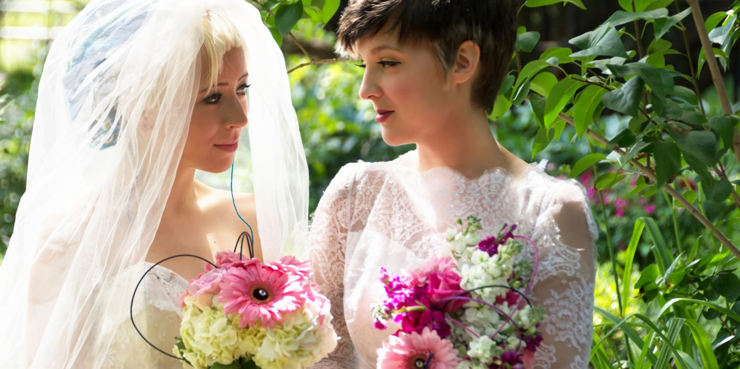 Two brides sharing an intimate moment.