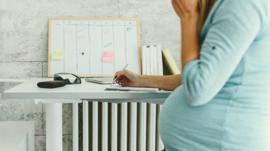 Pregnant Businesswoman Working In Her Home Office