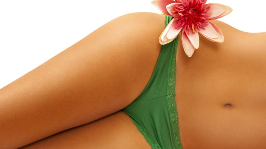 Perfect woman's body with cute flower on her hip ,
