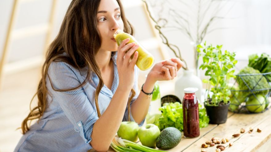 Woman with green healthy food at home